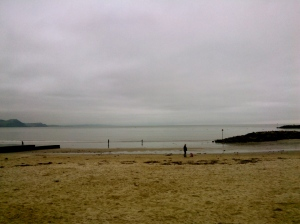 Peace and calm along Lyme Regis bay.