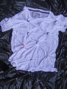 Twist sections of the tshirt and hold them in place with rubber bands.